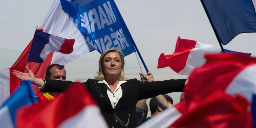 PARIS, FRANCE - MAY 01: Marine Le Pen gestures as she delivers a speech during the French Far Right Party May Day demonstration on May 1, 2012 in Paris, France. Marine Le Pen, the daughter of the French far-right leader Jean-Marie Le Pen, received only 6.4 million votes in the first round of the presidential elections. Both current French President Nicolas Sarkozy and French Socialist Party candidate Francois Hollande are now fighting to win support from the French Far Right ahead of the second round elections on May 6.  (Photo by Pascal Le Segretain/Getty Images)
